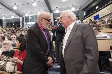 CERN July 2012: the day Higgs and Englert, the two future Laureates, met for the first time. (Source)